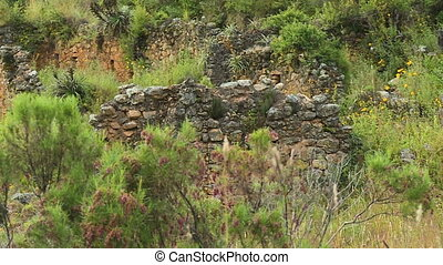 Small Wall Made of Stones - Steady, medium close up shot of...
