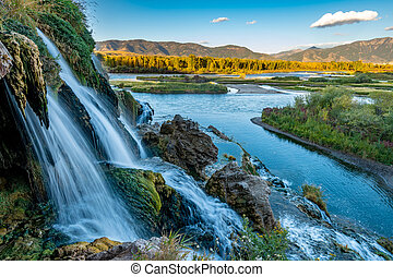 Small water fall flows into the Snake River in Idaho