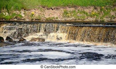 Small waterfall at sunny day. - Small waterfall at sunny...