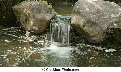 Small waterfall between the stones