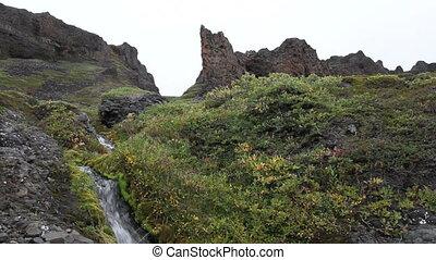 Small waterfall in beautiful surrou - A small waterfall in...