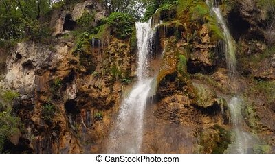 Plitvice Lakes National Park, Croatia.Small waterfall in the forest. Croatia, September