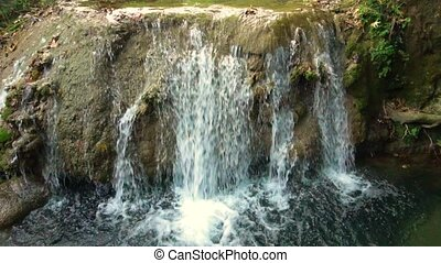 Small waterfall in jungle - Beautiful view of fresh water...