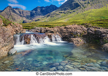 A small waterfall at the fairy pools on the Isle of Skye, Scotland