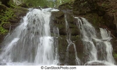 Small waterfall Shypit in Ukrainian Carpathian mountains. -...