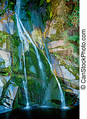 Small waterfall splashing in to a lagoon
