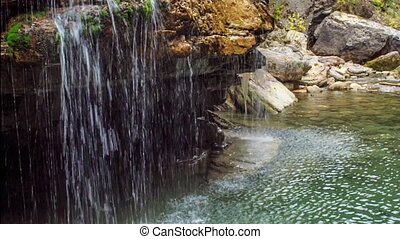 Small waterfall - Waterfall with clear spring water in...