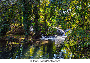 Wonderful  day - Small waterfalls on the Korana River. ...