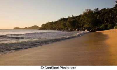 small waves and white beach at Seychelles islands. Mahe,...
