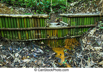 small weir bordered by a paddock with a rustic wooden fence