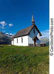 Small white church in the alps