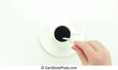 Small white cup of instant coffee - video on white...