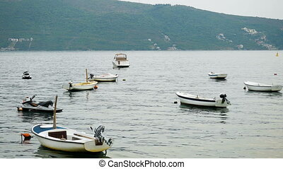 small white motor boats in the Bay in Montenegro