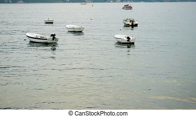 small white motor boats in the Bay in Montenegro in autumn