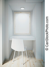 Small white office with blank frame on wall