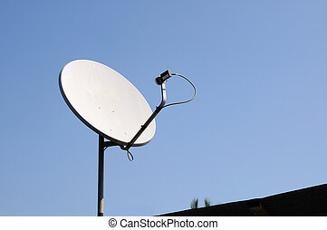 Small white telecommunication dish is mounted on the roof
