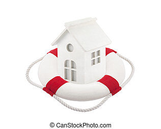 Small white toy house in lifebuoy over white background