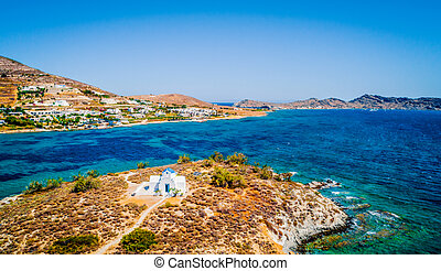 Small whitewashed orthodox church by the sea, aerial view