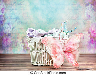 Small wicker basket with colorful background - Small wicker...