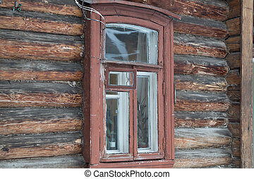 small window in  wall of old wooden house