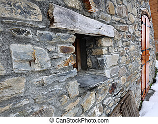 small window of a cottage - stone cottage with a small...