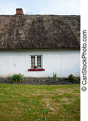 small window on irish cottage