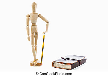 Small wood mannequin standing with pencil and calendar on white background