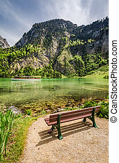 Small wooden bench at the Konigssee lake, Alps, Germany