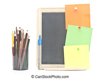small wooden blank blackboard with school stationery on white background