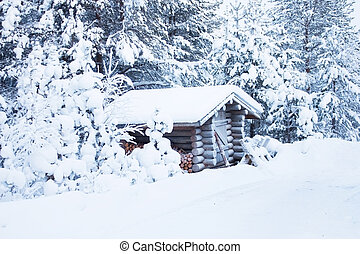 Small wooden blockhouse in the twilight, in winter under the snow in the snowy forest of pine trees, winter landscape