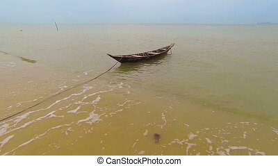 small wooden boat anchored - 1920x1080 FullHD video - Lonely...