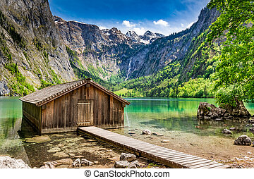 Small wooden cabin at the Obersee lake in German Alps