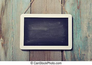 framed blackboard - Small wooden framed blackboard on wooden...
