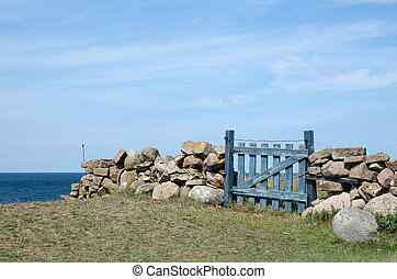 Small wooden gate by the coast - Small blue wooden gate by...
