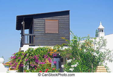 Small wooden house with flowers
