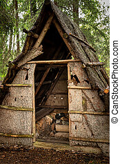 Small wooden hut of a woodworker in the forest