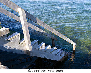 Small wooden jetty dock and staircase