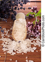 Small wooden shovel with bath salt and herbs