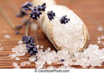 Small wooden shovel with bath salt and lavender