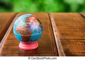 Small world globe standing on a desk