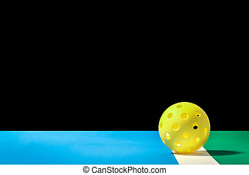 Small Yellow Pickleball with large background