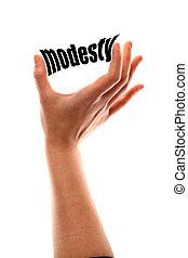 Smaller modesty concept - Color vertical shot of a of a hand...