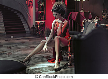 Smart, alluring lady in the stylish interior
