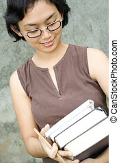 smart asian woman with books