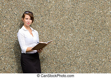 Smart attractive business woman writing in notebook