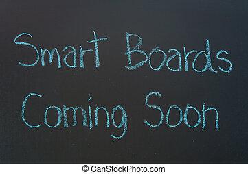 Smart Boards Coming Soon! written in white chalk on a black chalkboard