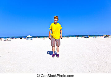 smart boy at the beach in South Miami