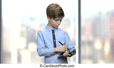 Smart boy drawing on tablet pc.