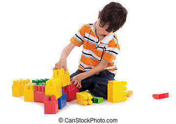 Smart boy playing with blocks