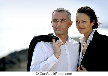 Smart business couple stood outdoors